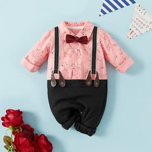 baby boys pink floral shirt and black pants romper suit with braces and matching bow tie