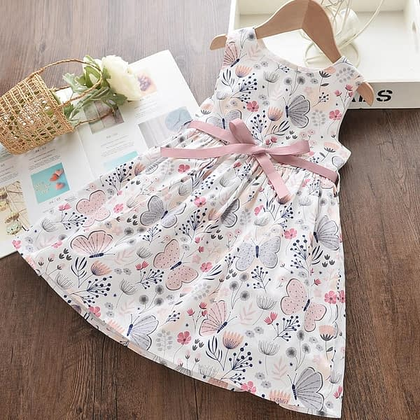 young childs pink and white floral and butterfly print occasion dress with pink belt