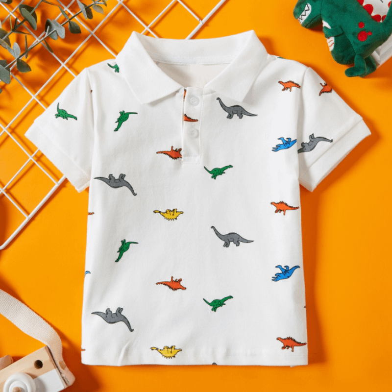 boys white short sleeve polo shirt with dinosaur print