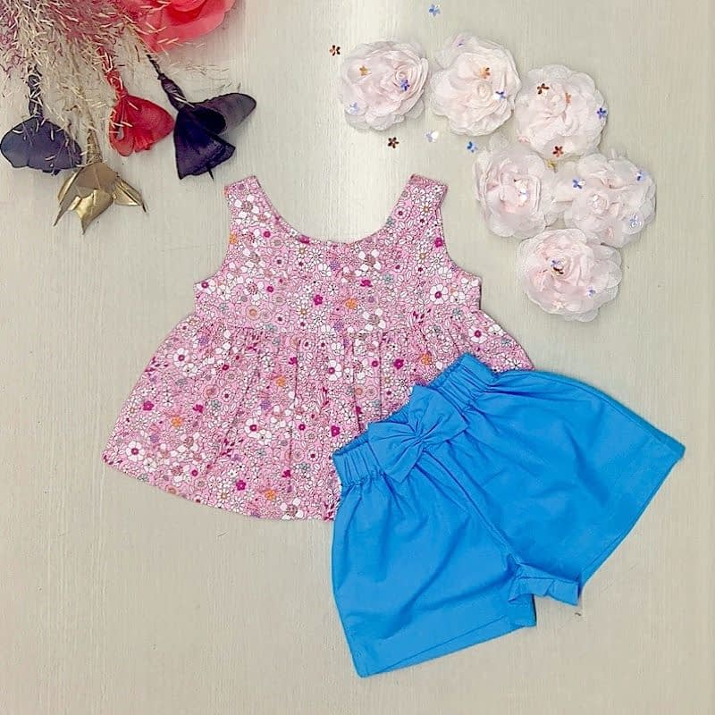 girls pink floral top and blue shorts summer set